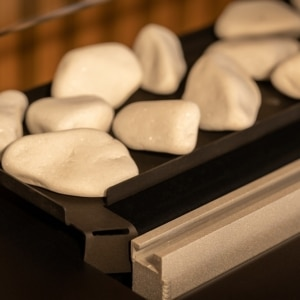 Tray with decorative white stones close up